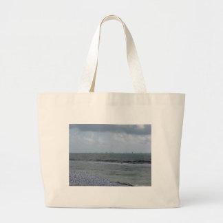 Seashore of beach with sailboats on the horizon large tote bag