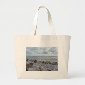 Seashore of beach with sailboats on the horizon large tote bag