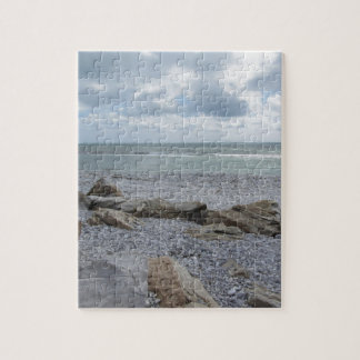 Seashore of beach with sailboats on the horizon puzzle