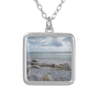 Seashore of beach with sailboats on the horizon silver plated necklace