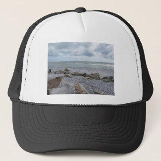 Seashore of beach with sailboats on the horizon trucker hat