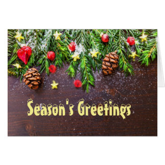 Seasons greetings pine cones and stars card