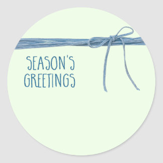 Season's Greetings Tied with String Classic Round Sticker