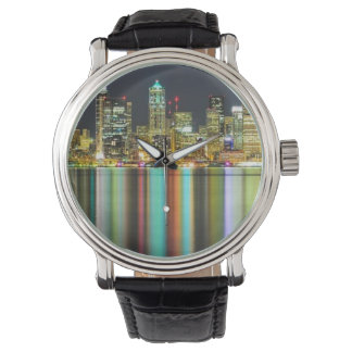 Seattle skyline at night with reflection watches