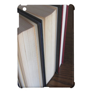 Second hand books standing on a wooden table iPad mini cover
