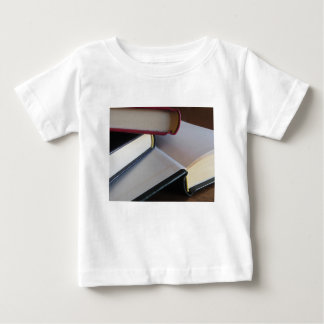 Second hand books with blank pages on a table baby T-Shirt