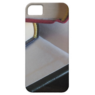 Second hand books with blank pages on a table iPhone 5 case