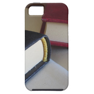 Second hand books with blank pages on a table tough iPhone 5 case