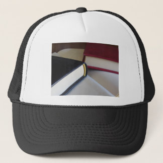 Second hand books with blank pages on a table trucker hat