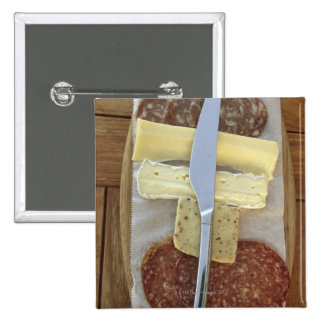 Selection of gourmet cheeses and cut meats 15 cm square badge