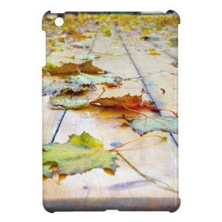 Selective focus on fallen autumn maple leaves clos iPad mini covers
