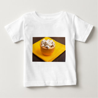 Selective focus on raw cashew nuts closeup baby T-Shirt