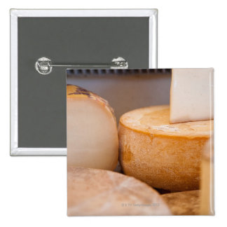 Selective focus photograph of cheeses in cheese 15 cm square badge