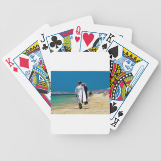Seller on the beach bicycle playing cards