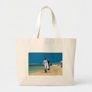 Seller on the beach large tote bag