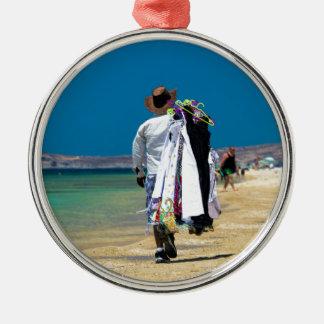 Seller on the beach metal ornament