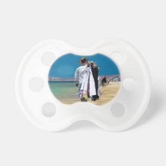 Seller on the beach pacifier