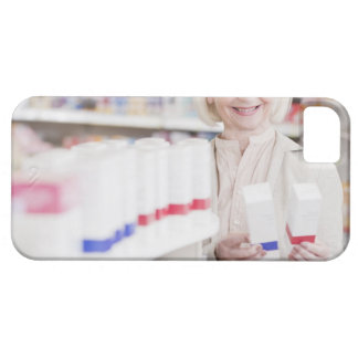 Senior woman comparing packages in drug store barely there iPhone 5 case