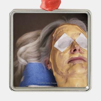 Senior woman having spa treament Silver-Colored square decoration