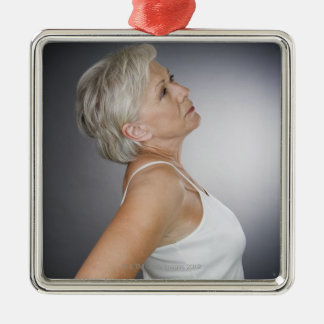Senior woman with backache Silver-Colored square decoration