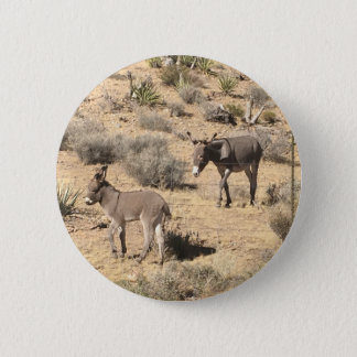 Separated by borders 6 cm round badge