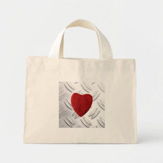 Serrated sheet background with heart mini tote bag