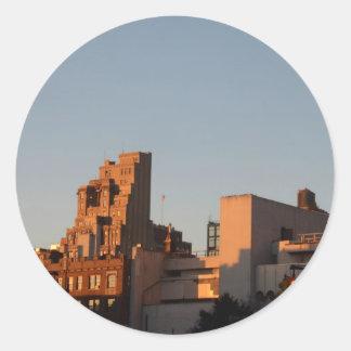 Setting sun illuminates old NYC Round Sticker