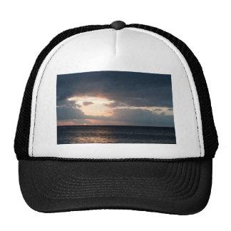 Setting sun over the ocean hat