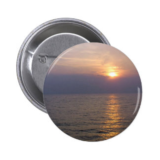 Setting sun over the sea pinback buttons