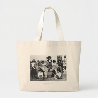 Seven rodeo cowgirls jokingly posing with a donkey jumbo tote bag