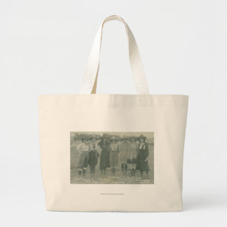 Seven rodeo cowgirls posing for a photograph. large tote bag