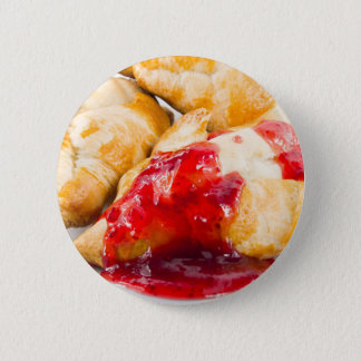 Several croissants with strawberry jam 6 cm round badge