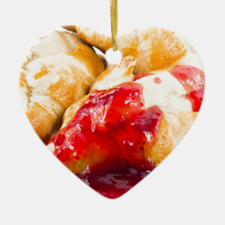 Several croissants with strawberry jam ceramic ornament