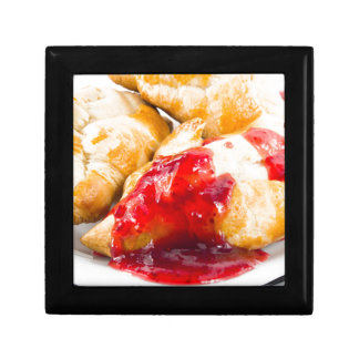 Several croissants with strawberry jam gift box