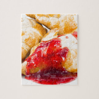 Several croissants with strawberry jam jigsaw puzzle