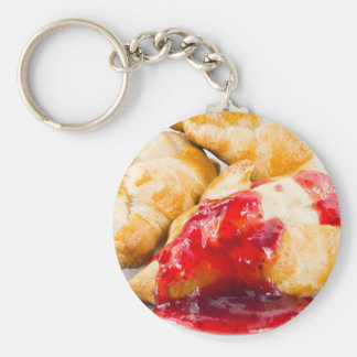 Several croissants with strawberry jam key ring