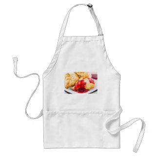 Several croissants with strawberry jam standard apron