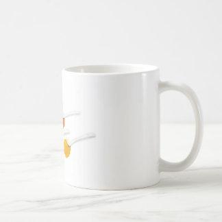 Several seasoning spices on porcelain spoons coffee mug