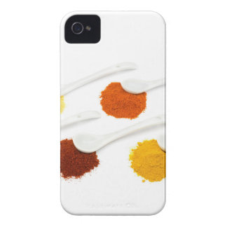 Several seasoning spices on porcelain spoons iPhone 4 covers