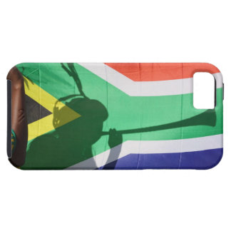 Shadow of soccer supporter blowing vuvuzela, case for the iPhone 5