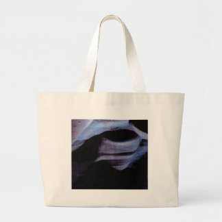 shadows in the rock wall large tote bag