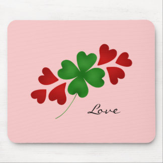 Shamrock and hearts on pink mouse pad