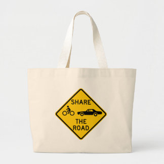 Share the Road Highway Sign Tote Bags