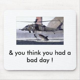 Shark attacks helicopter. mouse pad