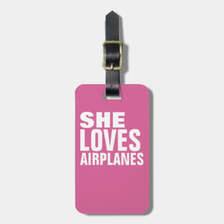 she loves airplanes, pink luggage tag