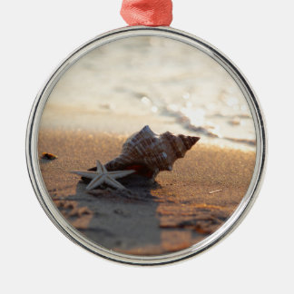 Shell at the sea metal ornament