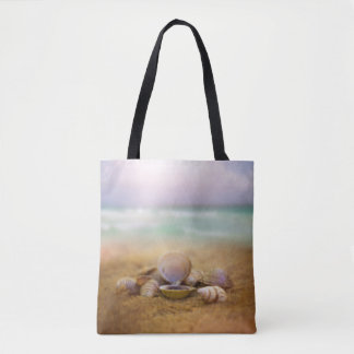 Shells on the beach with blue ocean water tote bag