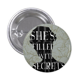 SHE'S FILLED WITH SECRETS 3 CM ROUND BADGE