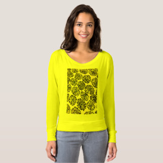 Shirt neon yellow with yellow and black flowers.