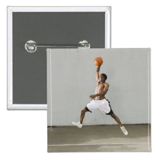 shirtless man jumping with a basketball 15 cm square badge